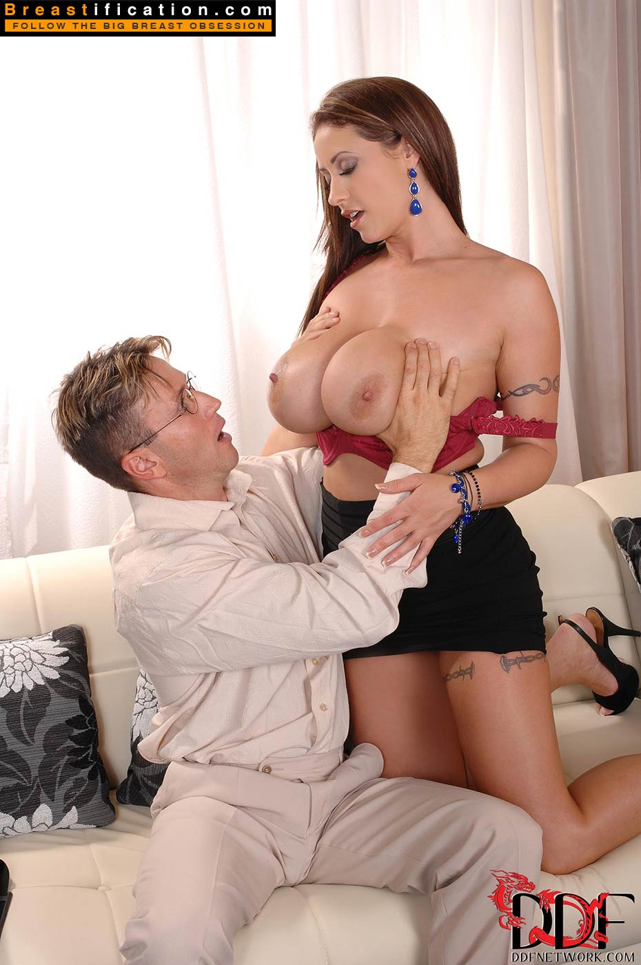 Sucking huge tits